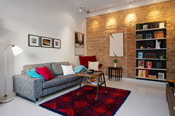 Gray Living Room with Red Brick Wall