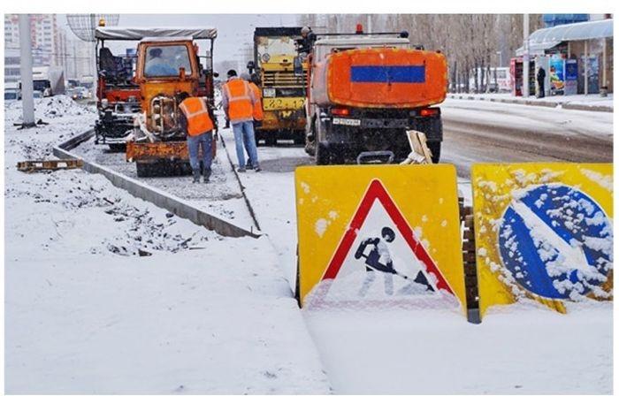 Rusi asflatiraju ulice preko snega