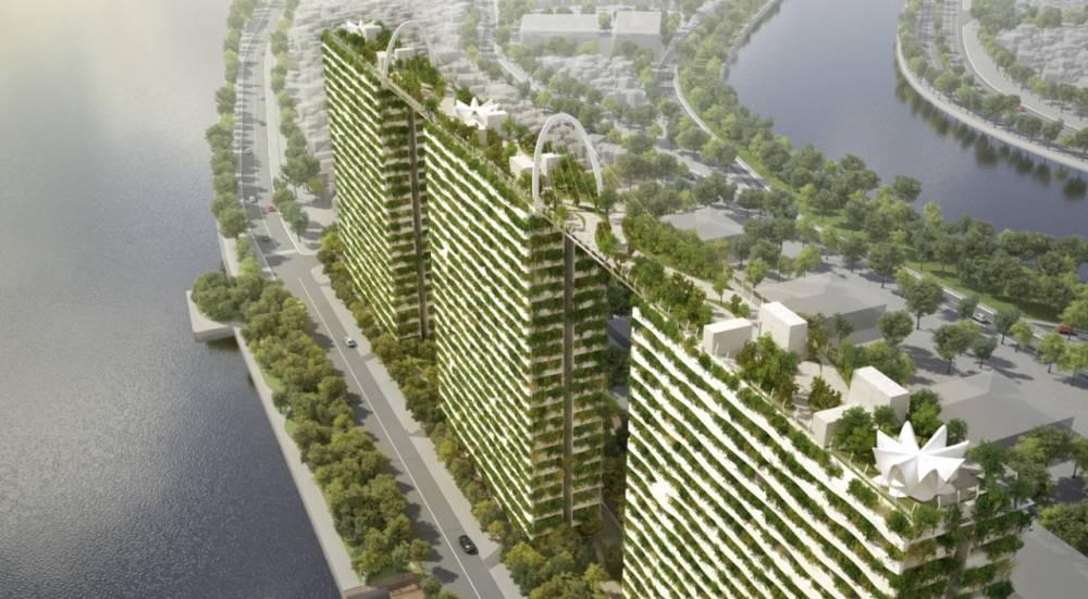 Tri stambene zgrade spojene zelenim krovom
