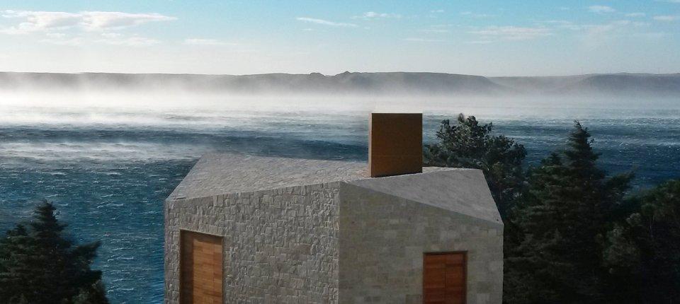 Kamena kuća na Jadranu oblikovana burom