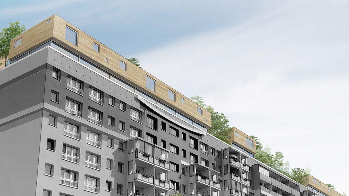 Drveni stambeni blokovi na ravnim krovovima postojećih zgrada