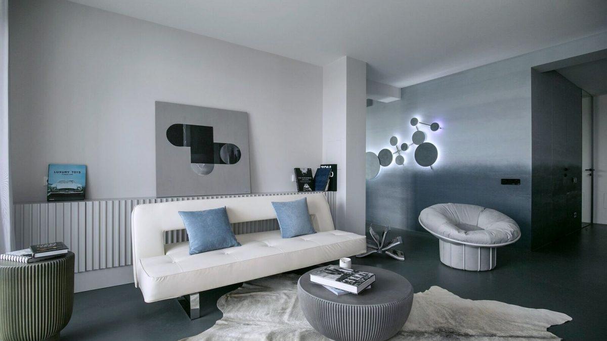 Monohromatska skala, oštar dizajn i inspiracija Mesecom definisale su enterijer ovog muškog stana